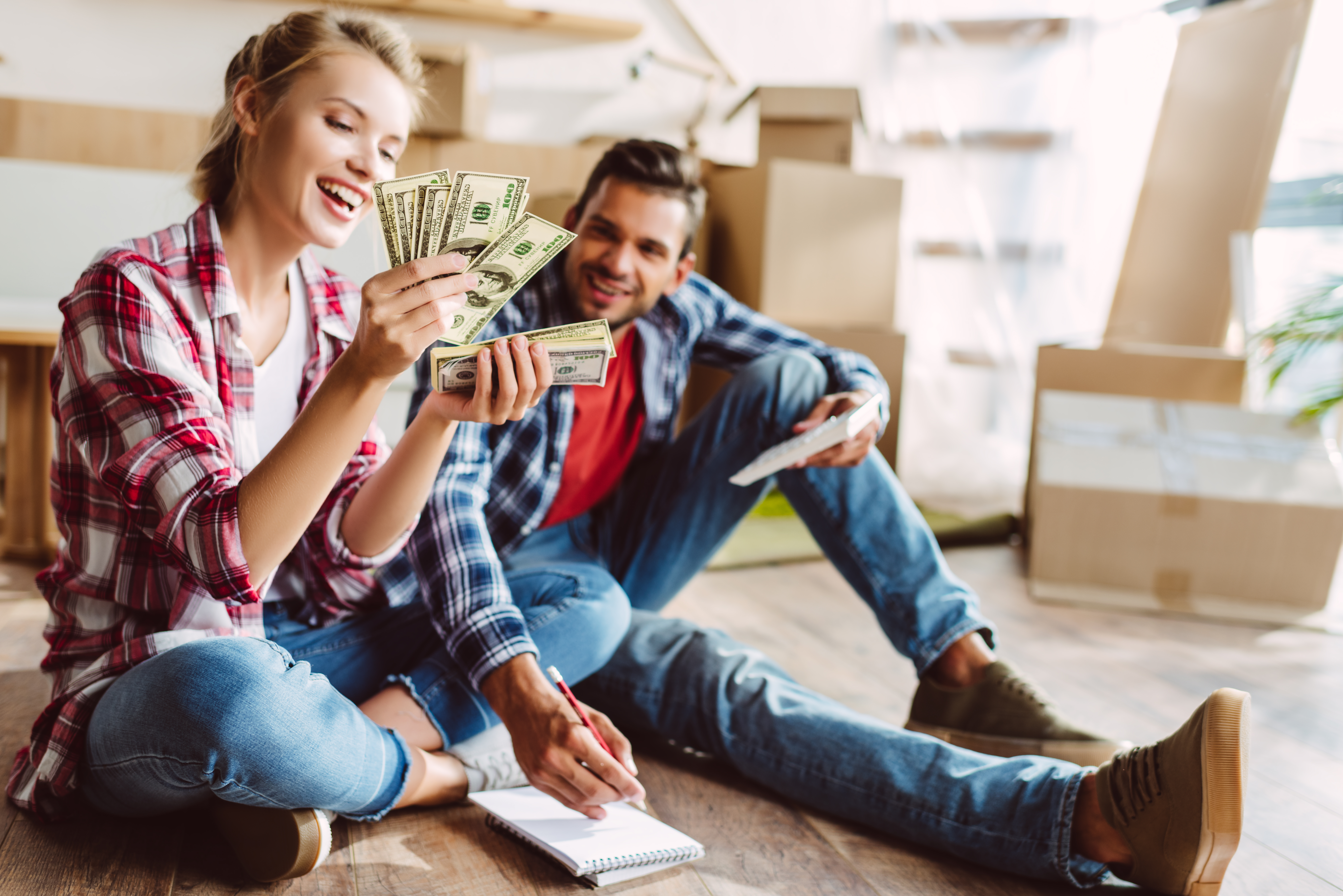 Young couple happy about having extra cash