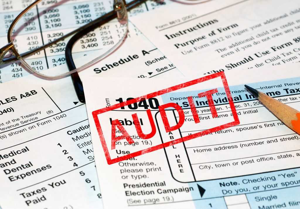Tax Documents Stamped with Red Audit Label