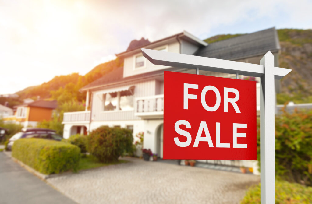 House with Red For Sale Sign