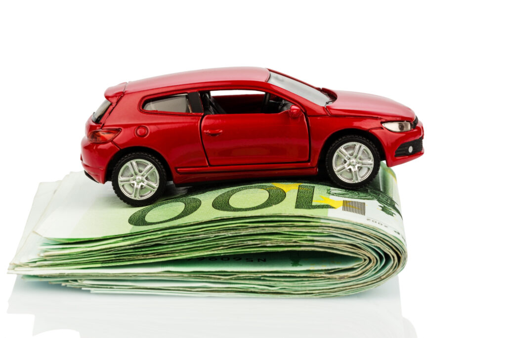 Red Toy Car on Folded Cash