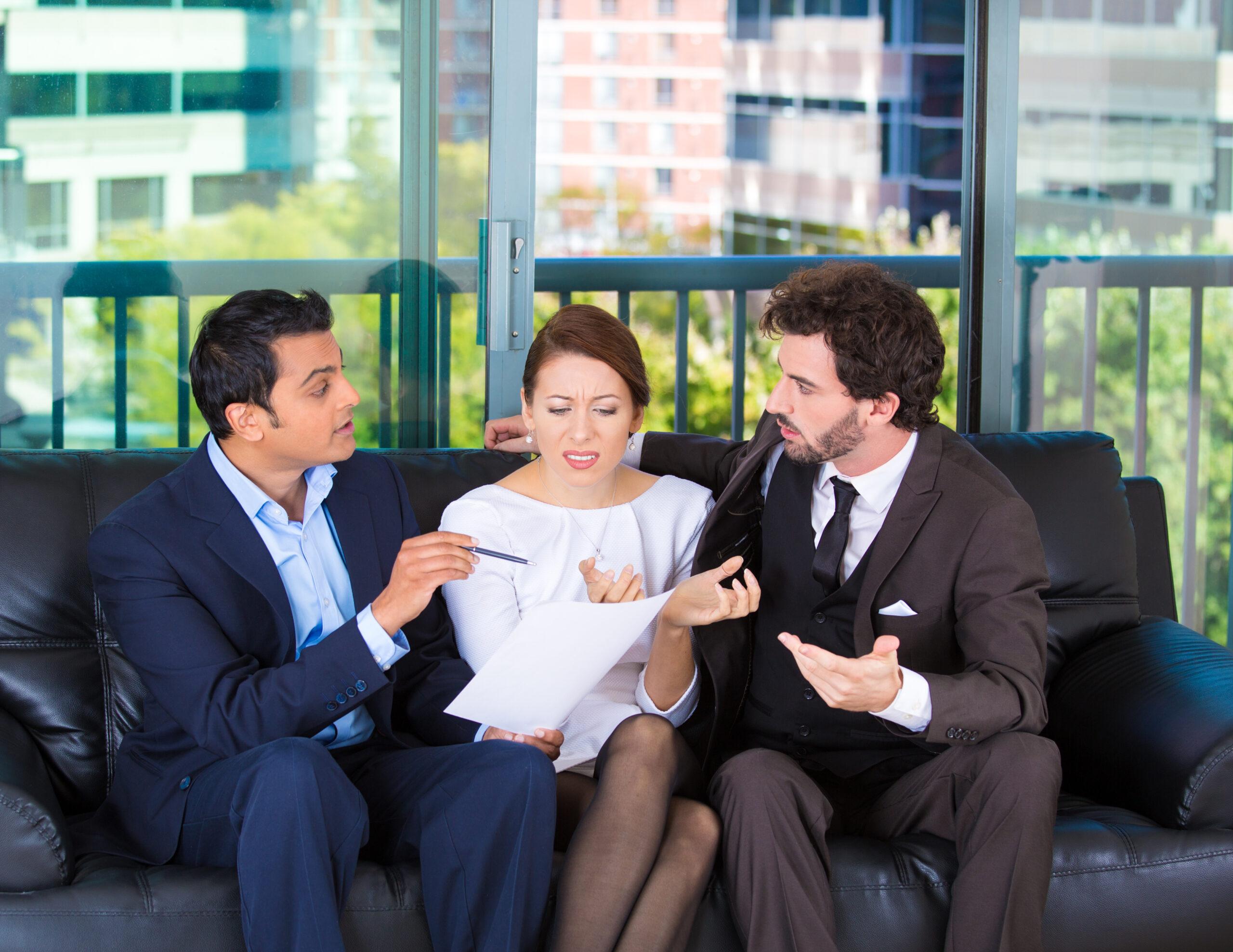 Woman Ignoring Business Men's Advice