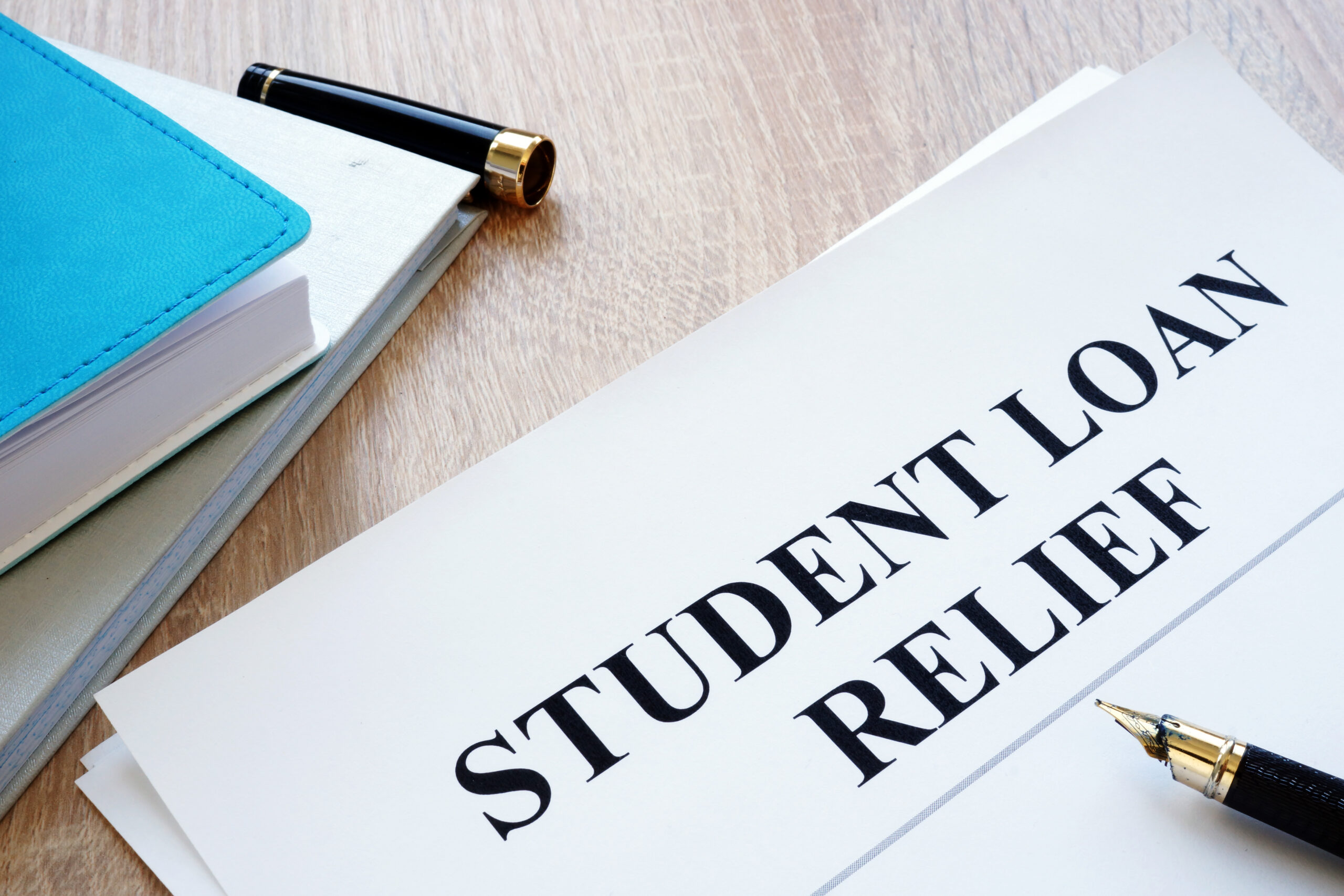 Student Loan Relief Application on Table
