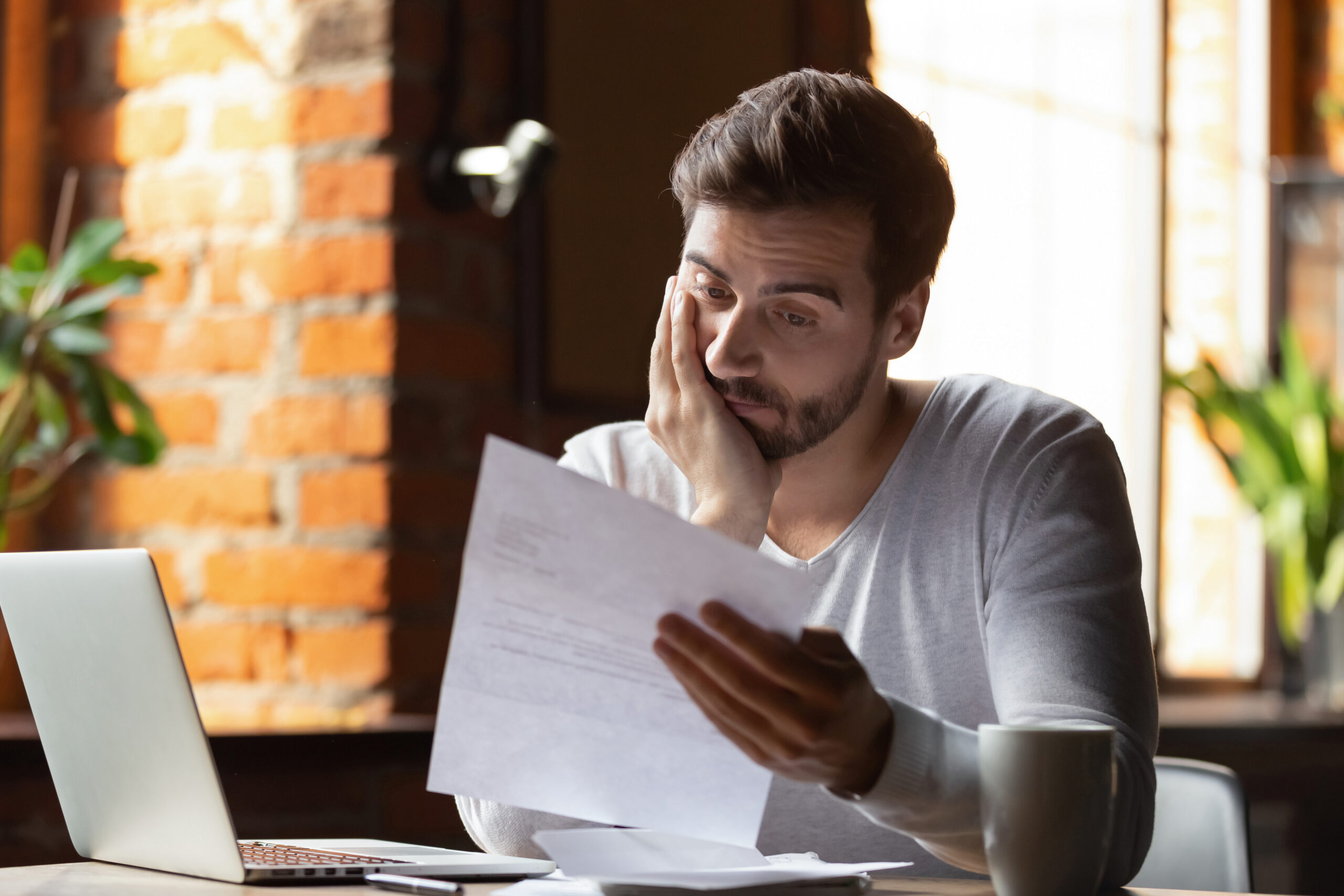 Man looks at Student Loan Notice